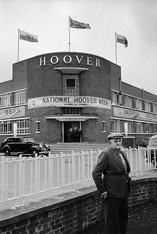 GB. Wales. Retired coal miner outside the Hoover factory in Merthyr Tydfil. 1961