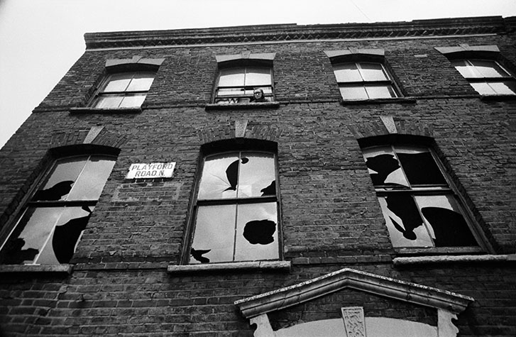 Remaining tenant of a house scheduled for demolition. It was a time when property owners were anxious to get rid of sitting tenants. 1963.