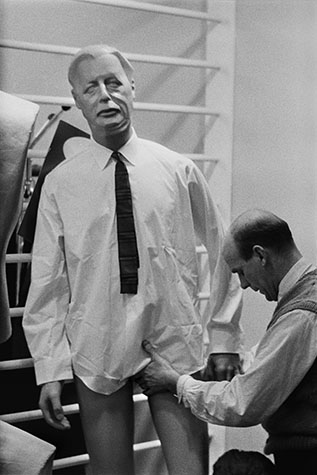 Harold Macmillan. The Prime Minister of the day was immortalised as a tailor' dummy. Here he was being dressed as part of a window display. 1963.