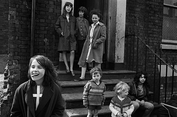 GB. England. Liverpool children. The area known as Liverpool 8 was a thriving artistic community where painters and poets intermingled with real people. Much of their work reflected life around them. The children, before TV, spent most of their time playing outside. 1966