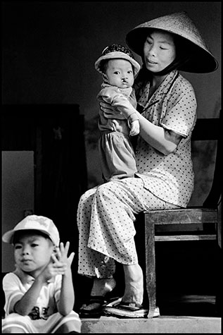 Cam Nghia, VIETNAM. 1998. 9 month old baby Hoang Huu Cuug, held by his mother Le Thi Ninh. His 2 older siblings were born normal. His parents spent the war in Cam Lo district.