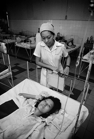 VIETNAM. Ho Chi Minh City. A young mother shortly after giving birth at the Tu Du Hospital. Her baby was born deformed with a small brain, defective mouth, ears and limbs. It died the following day. 1980