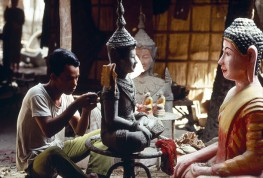 CAMBODIA. Phnom Penh. 1988. On grounds of Proyuvong pagoda, artisans produce religious artifacts.