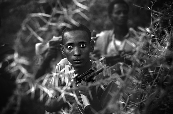 A fighter with the West Somalia Liberation Front. To compensate for food shortages, the soldiers consumed large quantities of 'khat', a leaf containing an amphetamine-like substance. This gave rise to many symptoms incompatible with good soldiering, including providing the enemy with an easy target. SOMALIA. 1980.