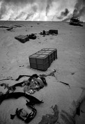KUWAIT. Dead soldiers lie in the sand while oil fires burn. Back in Washington, the oilmen running the government were pleased with their success in controlling the flow of essential oil to their economic competitor, Japan. 1991
