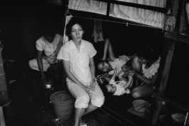 HONG KONG. Mother with her children in a refugee camp. Many spent years living in overcrowded conditions and many were forcibly repatriated to Viet Nam.