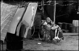 """USA. Texas. Juana Rodriguez, 89, is cared for by her granddaughter-in-law, Juana Snell. """"I want to cry when I don't have the water to wash her several times a day, she's like a baby"""" says Snell. 1987."""