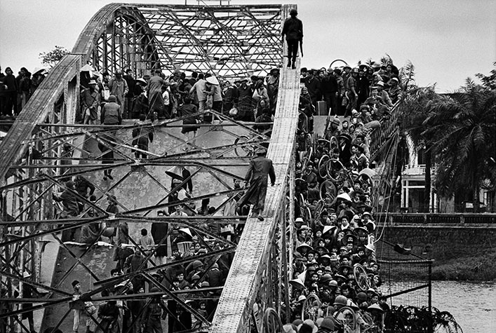 VIETNAM. Hue. Refugees flee across a damaged bridge. Marines intended to carry their counterattack from the southern side, right into the citadel of the city. Despite many guards, the Vietcong were able to swim underwater and blow up the bridge, using skin-diving equipment from the Marines.