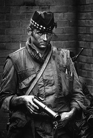 GB. NORTHERN IRELAND. This soldier was facing a hostile crowd of youngsters and, for a moment, his expression revealed his disdain. 1972