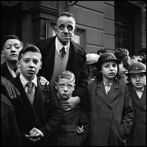 School Outing, Liverpool, 1952 This group of school children and their teacher were waiting to board a bus. Liverpudlians have always expressed an intensity rarely seen on other faces. When Evelyn Waugh described people like this in his novels, he was accused of fantasy.