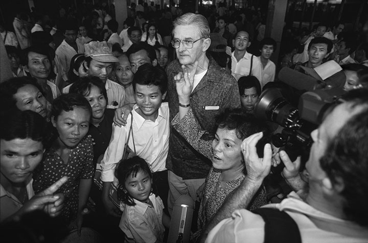 VIET NAM. An American father greets his son that he is seeing for the first time. Mr. Carl BAKERFIELD, who worked for Pacific Architects in Viet Nam during the war, embraces his 15 year-old son, Nguyen Thanh Hung, at Ho Chi Minh airport.
