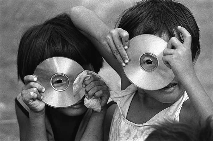 VIET NAM. 2002. The CD is seen as a most glittering jewel in the eyes of poor children.