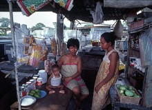 PHILIPPINES. Religion in the Philippines. A family running a store in a Manila cemetery where many families live. 1981.