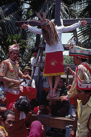 PHILIPPINES. Religion in the Philippines. In a church near San Fernando a 12 year old girl is crucified after dragging her cross to her own 'Golgotha'. 1981.
