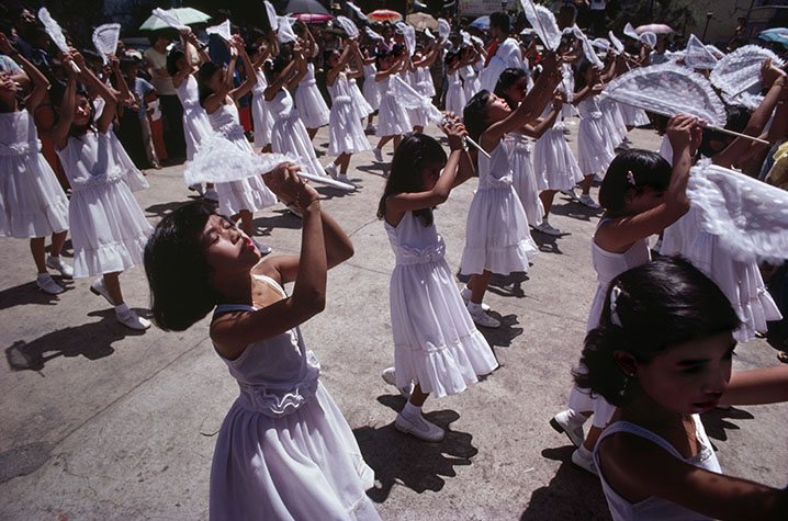PHILIPPINES. Religion in the Philippines. Young children dancing in a religious festival. 1981.