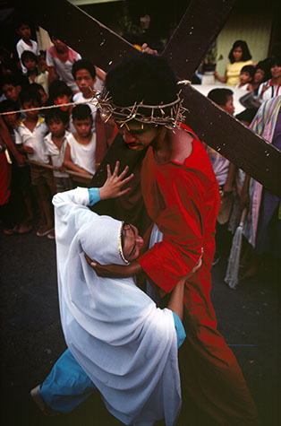 PHILIPPINES. Religion in the Philippines, Holy Cross Festival (Santacruzan), at the Nayong Pilipino Park in Pasay City where cruxifiction scenes are re-enacted. 1981.