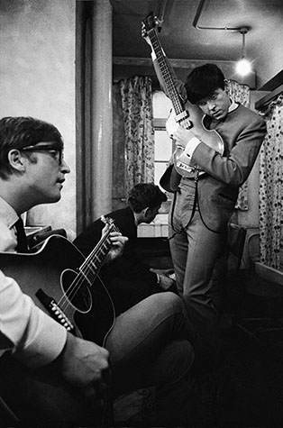 """I photographed the Beatles during their first concert in Liverpool. (Forgotten the name of the theatre, The Empire, perhaps.) I spent most of the time in their dressing room getting to know them. The highlight was the reading of letters from female fans that shocked the group. """"How do they even know about this stuff!"""" was one remark. Liverpool. England. 1963."""