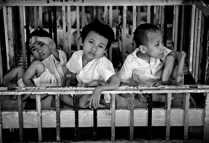 VIETNAM. Ho Chi Minh City. Three siblings exhibiting classic teratogenic symptoms, double elbows and knees on each limb, at Orphanage No. 6. They had been abandoned by their mother in the nearby Tu Duc Forest. 1980