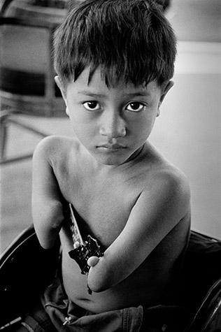 VIETNAM. Phnom Penh. Penh, fourteen, was born in the Tramkok district, Takeo Province. He begs with his parents, who have also moved to the city. With his handsome good looks he specializes in targeting open-air restaurants. 2000