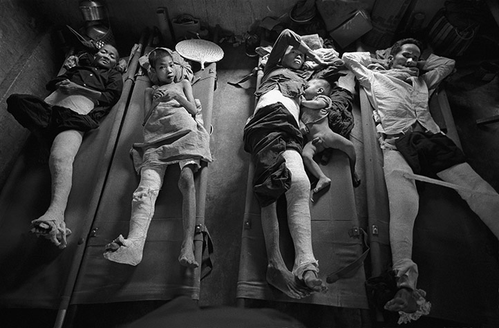 VIETNAM. South Vietnam. Quang Ngai. This group was not recovering from surgery so, to free up scarce beds, they transferred to an outbuilding to die.  The determination was made by the hospital's solitary Spanish surgeon.  There was no way he could operate on everyone; he explained with tears in his eyes,