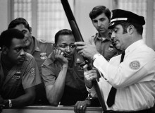 """USA. NEW YORK. The people of America love guns and the police are no exception. Here, they are being instructed in the use of the shotgun for """"crowd control."""" 1971"""
