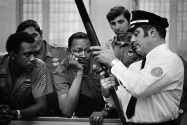 "USA. NEW YORK. The people of America love guns and the police are no exception. Here, they are being instructed in the use of the shotgun for ""crowd control."" 1971"