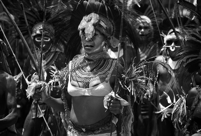 PAPUA NEW GUINEA. Woman wearing a bra sold to her by missionairies to cover up her nakedness. Missionaries are obsessed with breasts. These storm troopers of cultural imperialism impose brassieres on reluctant women (although some recipients do find then useful for carrying coconuts). 1973