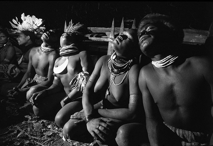PAPAU NEW GUINEA. I was allowed to attend this ceremony after it was established that I was not a missionary. To the accompaniment of rhythmic chanting, couples roll their heads against each others' with ever-increasing momentum. When the climax reached, copulation usually occurs - but on this occasion my flashgun lengthened the foreplay until my batteries ran out. 1973