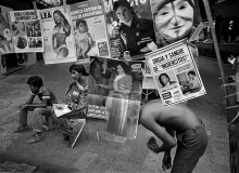 MEXICO. On a fine spring morning, these newspaper vendors were singing while reading their stock of magazines. Literacy, thanks to the paucity of TV sets, is still on the increase south of the border, whereas in North America it is declining rapidly. 1982
