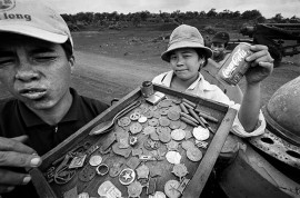 VIET NAM. Khe Sanh. The US Marines in Khe Sanh were under seige for 77 days. The attack was a decoy to lure troops away from the lowlands so that the National Liberation Front could launch the Tet Offensive. Today, Khe Sanh is firmly on the tourist trail with children selling trinkets, few of them authentic.