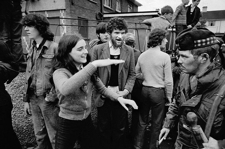 Derry/Londonderry. 1972. Catholic girl mocks a British soldier.