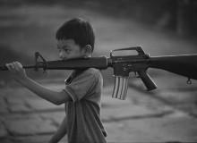 CAMBODIA. 1993. Boy with gun.
