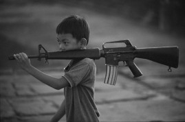 CAMBODIA. 1993. Boy with gun.