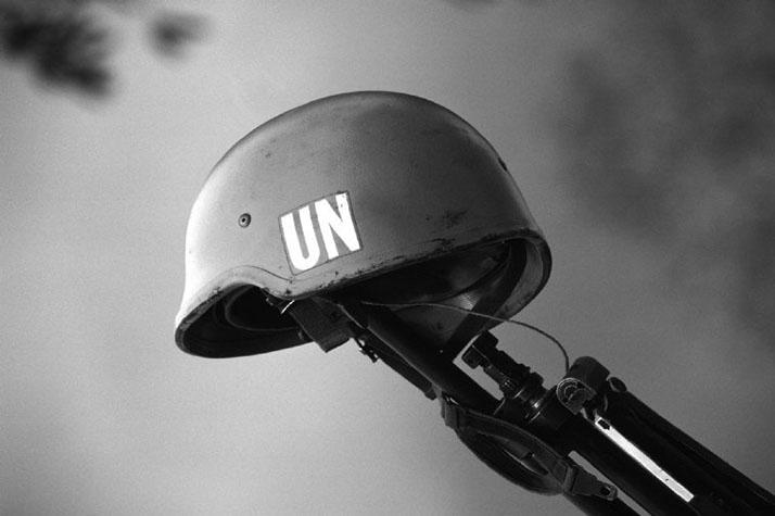 CAMBODIA. 1993. UN helmet on the end of a gun.