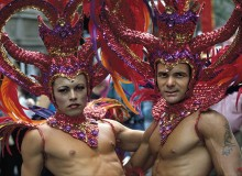 New York City. Gay Pride Parade. Two men sport elaborate headdresses.