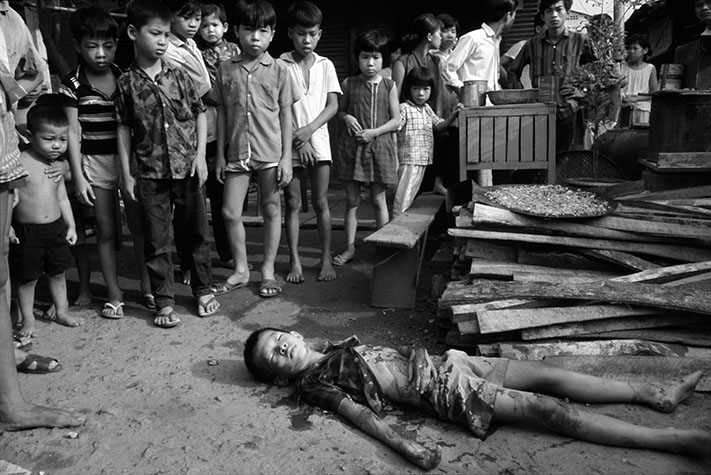 VIETNAM. This boy was killed by U.S. helicopter gunfire while on his way to church - a Catholic church - whose members were avid supporters of the government, who were in turn pro-American.  The result was a disillusioned urban population, reluctant to believe in or support their discredited leaders. 1968