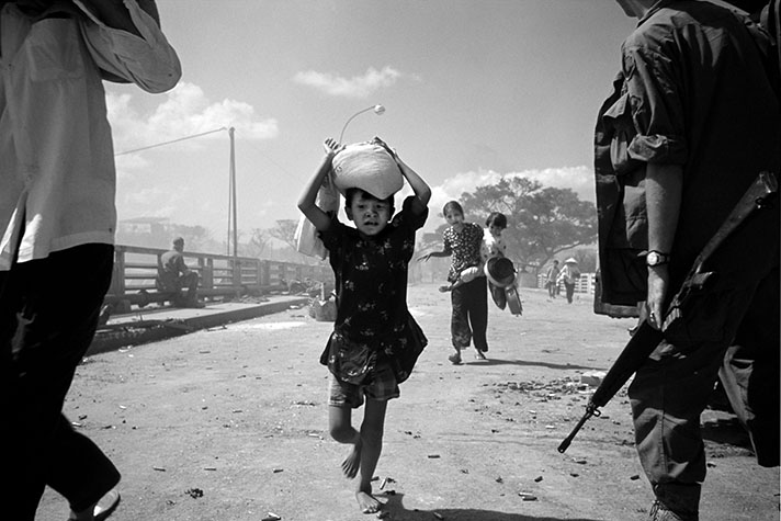 VIETNAM. The battle for Saigon. Refugees under fire. Confused urban warfare was such that Americans were shooting their staunchest supporters. 1968