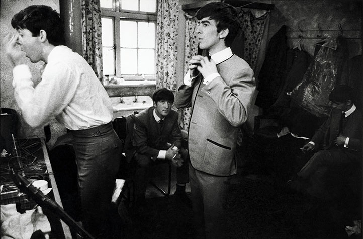 England. 1961. The Beatles in the early years. Here they are in a dressing room.
